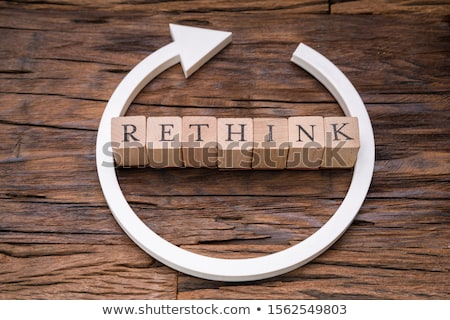 Wooden Blocks With Rethink Word And Arrow Over Wooden Surface Stock photo © AndreyPopov
