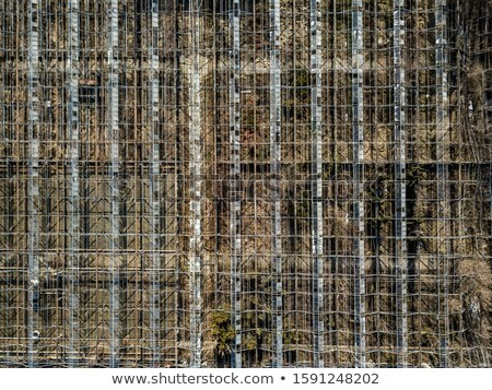 Metal framework of greenhouses on a ground of drone view. Stock photo © artjazz