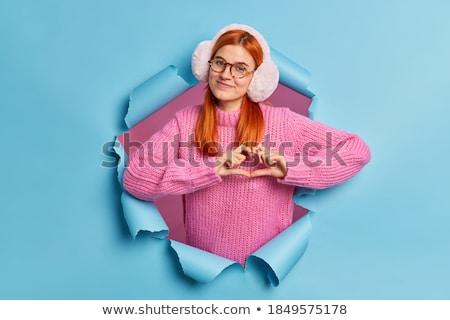 red haired teenage girl making finger glasses stock photo © dolgachov