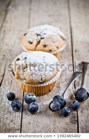 Two homemade fresh muffins with sugar powder, vintage spoons and Stock photo © marylooo