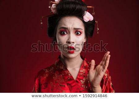 Image of shocked geisha woman in japanese kimono gesturing hand Stock photo © deandrobot