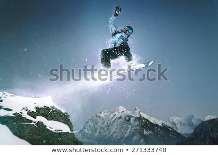 Homme équitation planche à neige extrême sports d'hiver montagne Photo stock © robuart