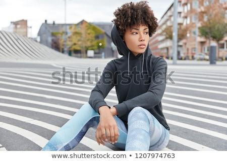 Töprengő fiatal afrikai nő visel lezser Stock fotó © deandrobot