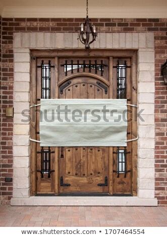 Medical Face Mask Covering Front Door of House Stock photo © feverpitch