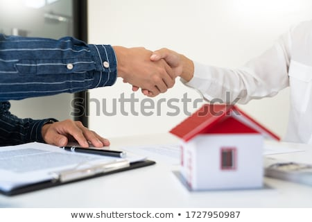 House developers and customer shaking hand after accept agreemen Stock photo © snowing