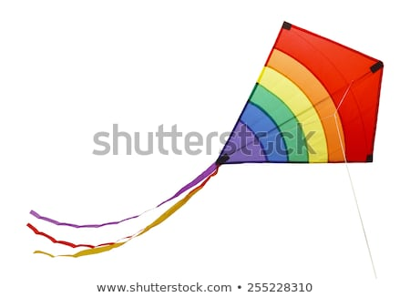 Stock photo: Rainbow colored kite flying high