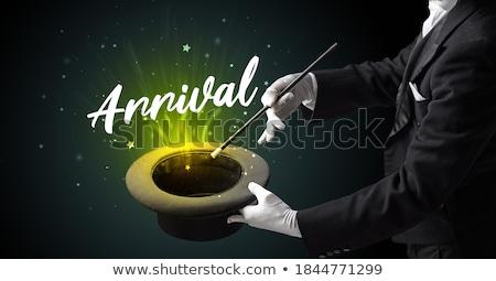 Magician or illusionist is showing magic trick Stock photo © ra2studio