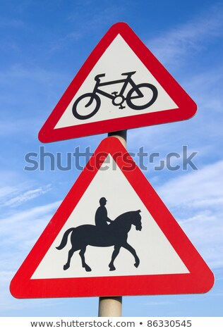 british cycle route ahead accompanied horses or ponies road signs stock photo © latent