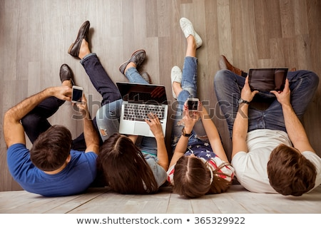 Boy listening to music and girl using laptop computer Stock photo © photography33