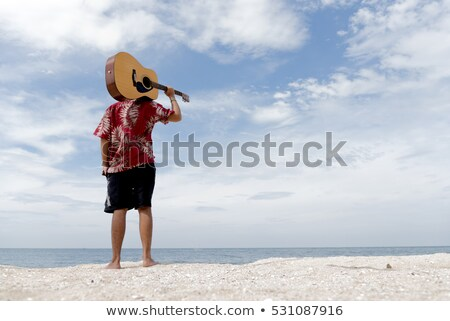 Jóvenes hombre guapo azul guitarra blanco modelo Foto stock © Elmiko