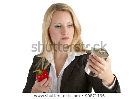 Woman Comparing Fresh To Tinned Vegetables Stock photo © Amosnet