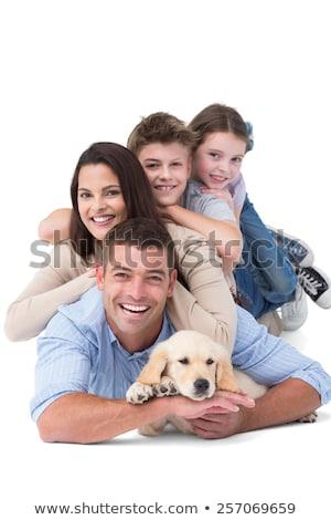 портрет · счастливая · семья · ковер · тесные · вместе · улыбаясь - Сток-фото © get4net