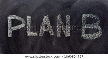 charts of strategy written with chalk on a blackboard stock photo © bbbar