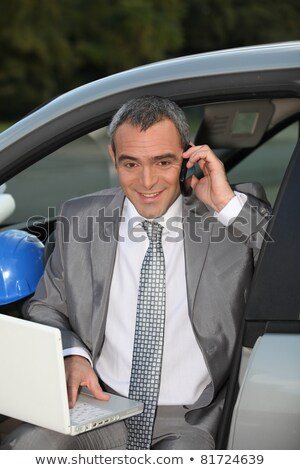 architect in car speaking on mobile telephone stock photo © photography33