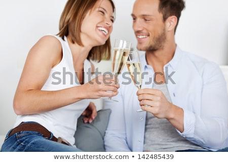 Casal potável champanhe mulher festa Foto stock © photography33
