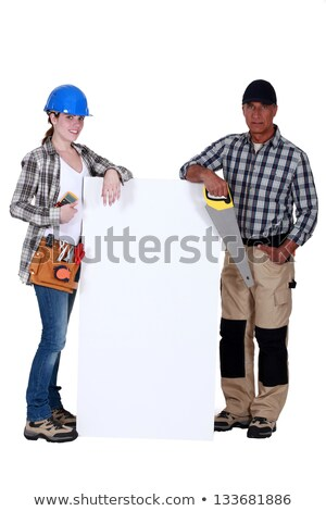 craftswoman and craftsman posing next to a blank poster Stock photo © photography33