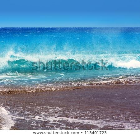 Canary Islands brown sand beach rough turquoise waves Stock photo © lunamarina