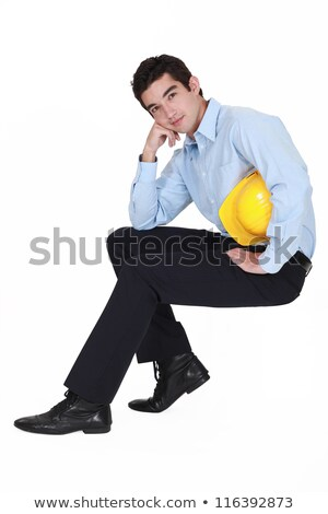 young engineer sitting on an invisible stool stock photo © photography33