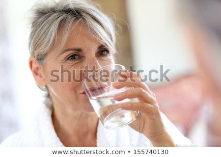 シニア 女性 ガラス 水 笑顔 顔 ストックフォト © photography33