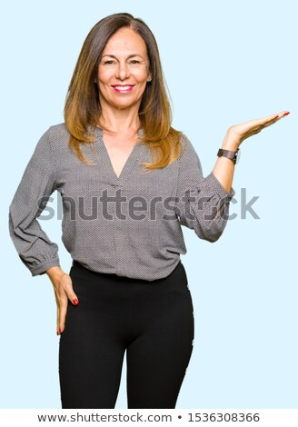 Casual middle aged woman pointing at the camera stock photo © stockyimages