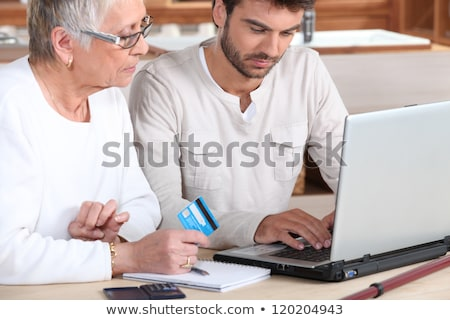 Man helping elderly family member shop on-line Stock photo © photography33