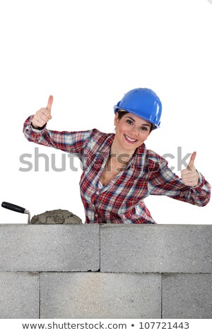 A female construction worker with both thumbs up. Stock photo © photography33