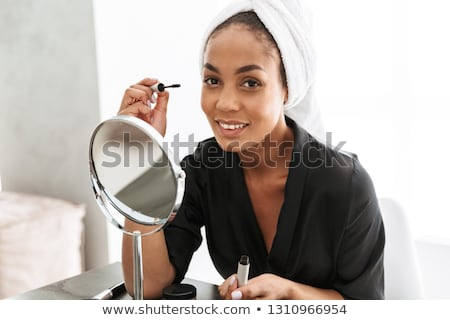 Brunette mascara miroir femme main Photo stock © photography33