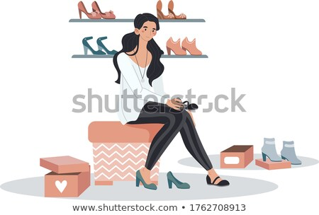 woman fits on white boots in a boutique Stock photo © ssuaphoto