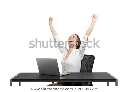 Happy woman with raised arms and laptop against a white background Stock photo © wavebreak_media