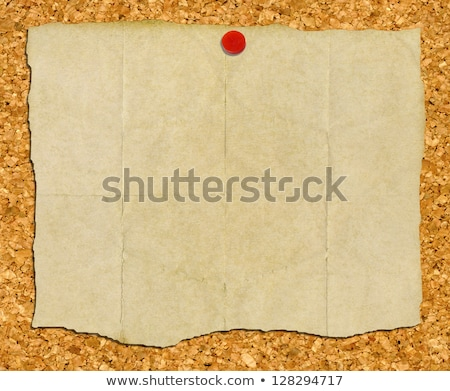 Vintage torn paper stuck to a cork noticeboard. Stock photo © latent