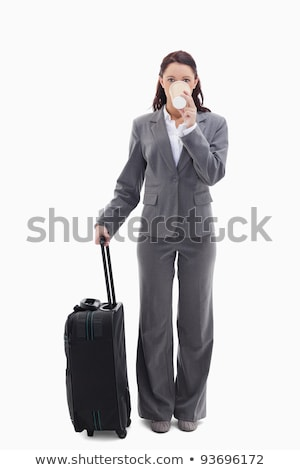 Businesswoman with a suitcase drinking a coffee against white background stock photo © wavebreak_media