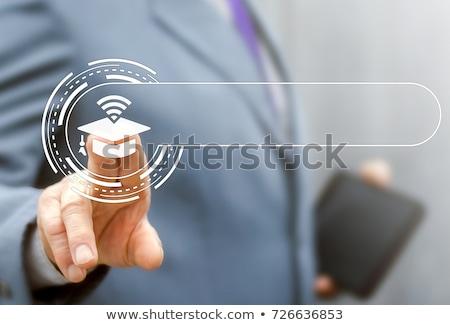 Graduating Button - Education Concept. Stock photo © tashatuvango