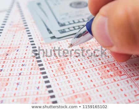 Marked lottery ticket Stock photo © deyangeorgiev