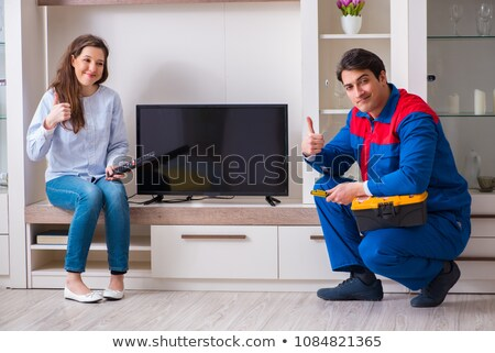 Electrician repairing broken television Stock photo © photography33