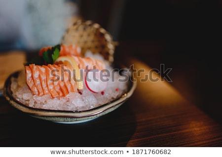 Stock fotó: Fish Rolls In Ice Cube