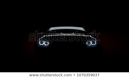 Stock photo: Silhouette of car with headlights in darkness