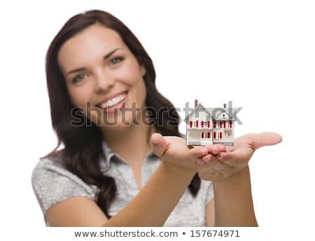 Félvér nő tart kicsi ház izolált Stock fotó © feverpitch