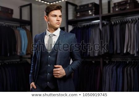 若い男 スーツ ハンガー 白 手 ボディ ストックフォト © utorro