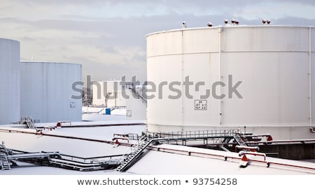 white tanks in tank farm with snow in winter stock photo © meinzahn