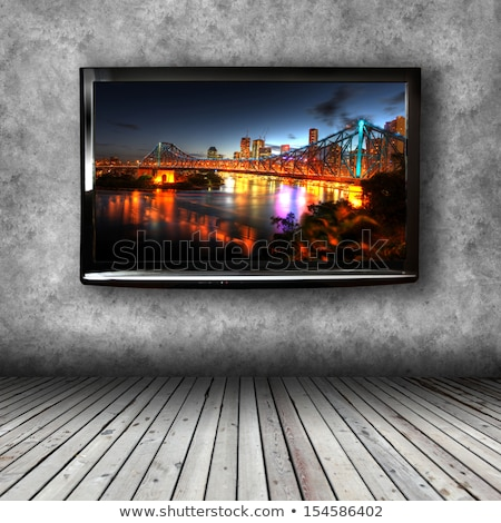 wide screen television in wooden room stock photo © tungphoto