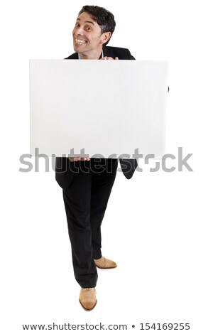 Businessman with a cheesy grin holding a sign Stock photo © smithore