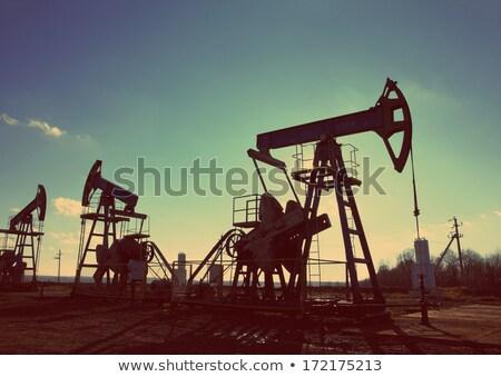 oil pumps silhouette against sun - vintage retro style Stock photo © Mikko