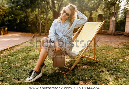 Photo stock: Fashionable Woman Sitting In Silver Chair