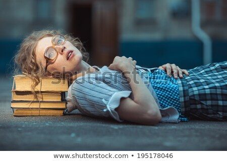 Funny crazy girl student with glasses lying on a pile of books Stock photo © vlad_star