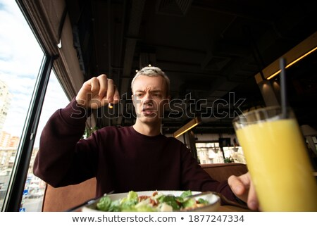 young brunette looking for something to eat stock photo © amok