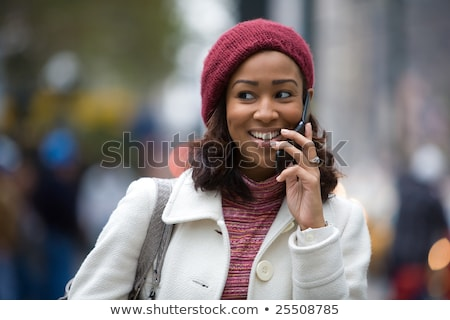 Woman drinking coffee as she talks on her mobile Stock photo © dash