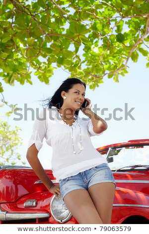 Smiling woman talking on phone in a cabriolet car Stock photo © vlad_star