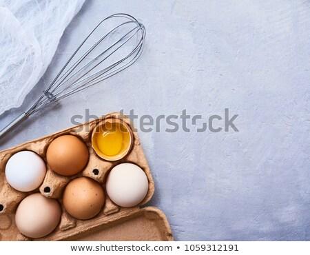 Nyers tojások habaró húsvét asztal reggeli Stock fotó © yelenayemchuk