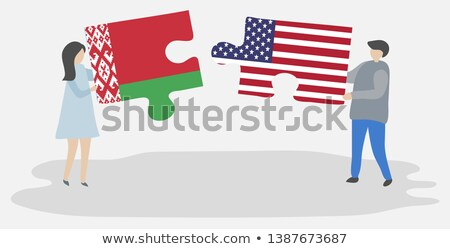 usa and belarus flags in puzzle stock photo © istanbul2009