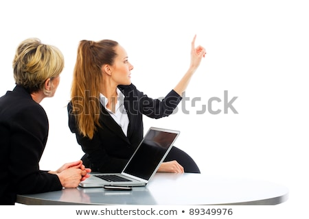 two women during a business meeting with laptop on white background studio Stock photo © ambro